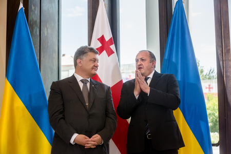 delegation: TBILISI, GEORGIA, Jul. 18, 2017: State visit of the president of Ukraine to Georgia. Georgian President Giorgi Margvelashvili and President of Ukraine Petro Poroshenko during a meeting in Tbilisi