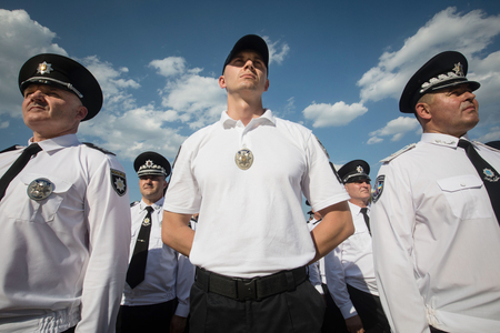 battalion: KIEV, UKRAINE - Aug 04, 2017: Law enforcers during solemn events on the occasion of the second anniversary of the creation of the National Police of Ukraine on Sofiyskaya Square, in Kiev Editorial