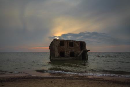 Sunset over old demolished military forts. Abandoned fortifications at Baltic sea coast in Liepaja, Latvia.