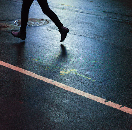 down lights: Lights and shadows of New York City. Silhouette of a man running down the street