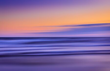 Abstract blurred sea landscape and sunset cloudy sky background
