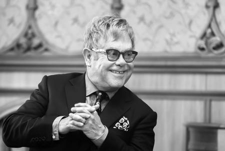 KIEV, UKRAINE - Sep 12, 2015: Black and white portrait of world-famous musician, composer and singer Elton John during his meeting with President of Ukraine Petro Poroshenko