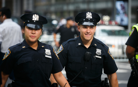 NEW YORK, USA - Sep 21, 2017: Police officers performing his duties on the streets of Manhattan. New York City Police Department (NYPD) is the largest municipal police force in the United States 報道画像