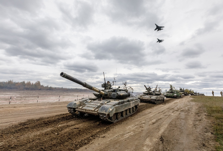 ZHYTOMYR Reg, UKRAINE - Oct. 14, 2017: Column of tanks and fighters in the sky. Combat training of the Armed Forces of Ukraine in the training center of Zhytomyr region. Editorial