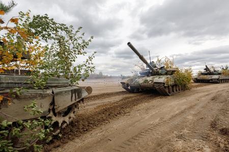 ZHYTOMYR Reg, UKRAINE - Oct. 14, 2017: Column of tanks. Combat training of the Armed Forces of Ukraine in the training center of Zhytomyr region. Editorial