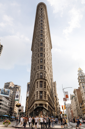 fifth avenue: NEW YORK, USA - Sep 16, 2017: Flatiron Building in NYC. Originally the Fuller Building, is a triangular steel-framed landmarked building located at 175 Fifth Avenue in the borough of Manhattan