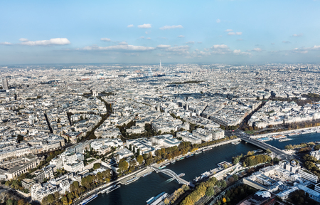 Cityscape of Paris City. Aerial panoramic view of Paris roofs and Seine river as seen from Eiffel Tower in autumn time Standard-Bild
