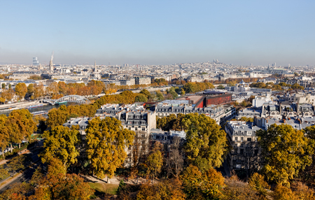 Cityscape of Paris City. Aerial panoramic view of Paris roofs and Seine river as seen from Eiffel Tower in autumn time Stock Photo