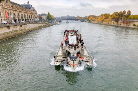 PARIS, FRANCE - Nov 09, 2017: Cruise ship on the Seine in Paris
