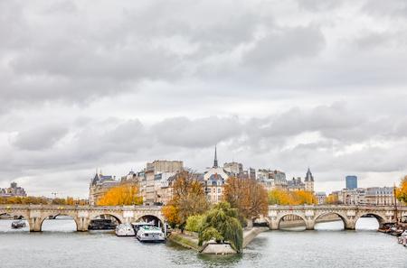 PARIS; FRANCE - Nov 10; 2017: Cite Island and Bridge Neuf. Pont Neuf is the oldest standing bridge across the river Seine in Paris Редакционное