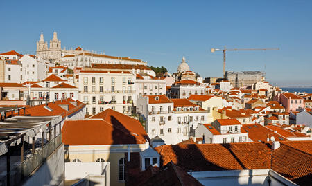 LISBON, PORTUGAL - Dec. 18, 2017: Lisbon town skyline at the Alfama the oldest district of Lisbon, spreading on the slope between the Sao Jorge Castle and the Tejo river Editorial
