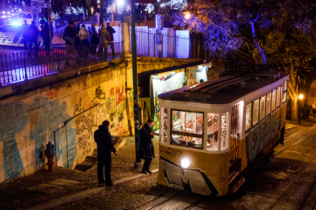 LISBON, PORTUGAL - Dec. 17, 2017: Lisbon Tram and Funicular Network at night. Gloria Funicular is a funicular railway line in the civil parish of Santo Antonio, in the municipality of Lisbon Editorial