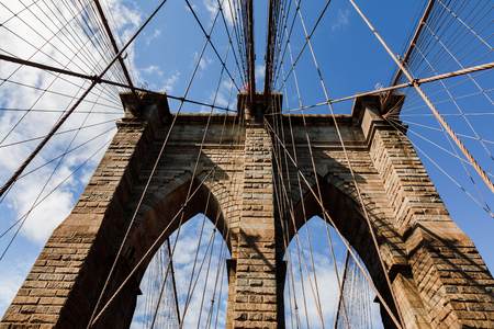 Brooklyn Bridge in New York City. Brooklyn Bridge is a hybrid cable-stayed suspension bridge in NYC and is one of the oldest roadway bridges in the United States