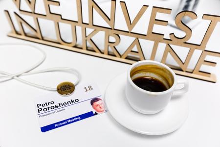 DAVOS, SWITZERLAND - Jan 25, 2018: President of Ukraine Petro Poroshenkos badge and a cup of morning coffee during World Economic Forum Annual Meeting 2018 in Davos Editorial