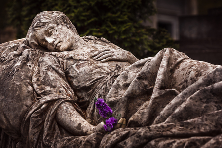 Old statue on grave in the Lychakivskyj cemetery of Lviv, Ukraine. Vintage look image