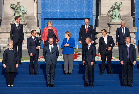 BRUSSELS, BELGIUM - Jul 11, 2018: Jens Stoltenberg, Donald Trump,  Emmanuel Macron and Angela Merkel at the group photo of participants of the NATO military alliance summit