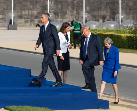 BRUSSELS, BELGIUM - Jul 11, 2018: NATO Secretary General Jens Stoltenberg, US President Donald Trump and British Prime Minister Teresa May during the summit of the NATO military alliance