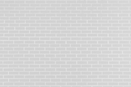 Abstract light gray background. Vintage bricklaying structure. Brick wall background