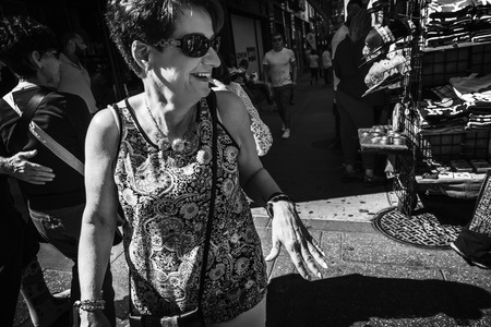 NEW YORK, USA - Sep 23, 2017: Black and white Manhattan street scene. New Yorkers and tourists in a hurry about their business, walking and relaxing on Times Square in NYC