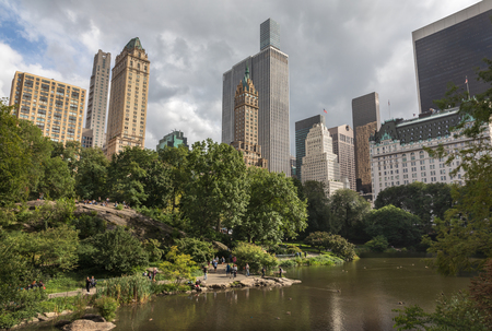 New York, USA - Sep 24, 2018: Pond in the central park in NYC. Central Park and Manhattan Skyline. Midtown Manhattan skyline view from Central Park