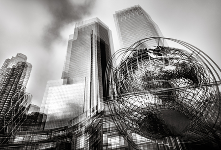 Black and white abstract image of iconic sculpture of Earth in front of Trump Towers at Columbus Circle in Manhattan Stock Photo