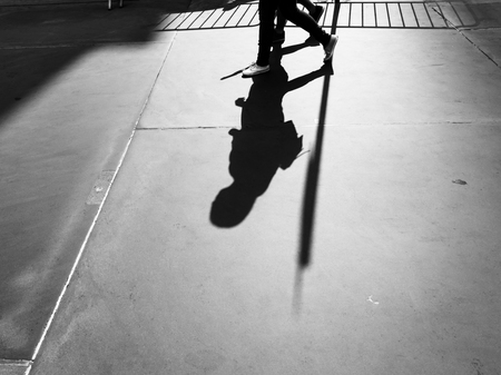 Light and shadows in New York City. Shadows of people walking street in morning light