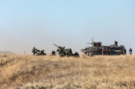 DONETSK REG, UKRAINE - Okt 12, 2018: Military equipment at a military training ground during complex tactical exercises of diverse military forces for the defense of coastal area in the Donetsk region