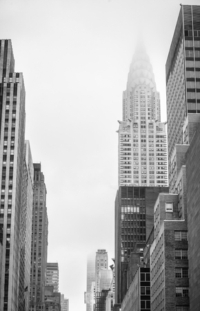 New York, USA - May 03, 2016: W 42 street in NYC. Chrysler Building and Manhattan modern architecture. Manhattan is the most densely populated of the five boroughs of New York City