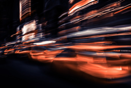 Illumination and night lights of NYC. Abstract image of neon lights on the streets of New York City. Multiple exposure and intentional motion blur 写真素材