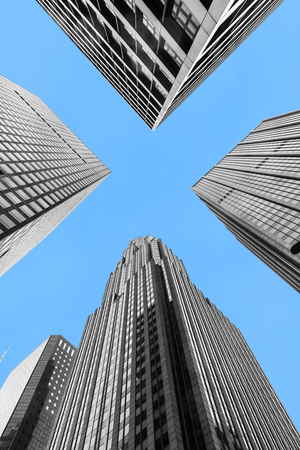 Modern black and white skyscrapers of New York City isolated on blue sky background