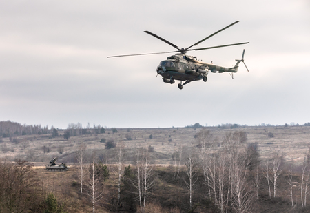 ZHYTOMYR Reg, UKRAINE - Nov. 21, 2018: Combat training at the training center of the airborne troops of the Ukrainian Armed Forces in Zhytomyr region. Helicopters during combat missions