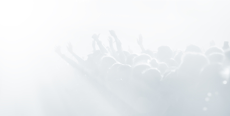 Crowd of spectators at a concert in light blue tonality. High key background with a people on an open playground at a concert. Abstract soft focus image with copy space Stock Photo