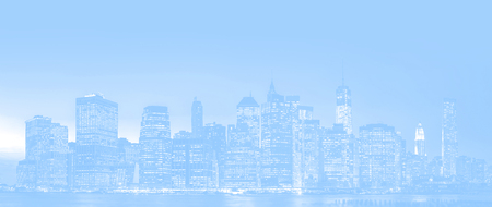 New York City skyline panorama with night lights and reflections.  Image of Manhattan in light blue tonality Stock Photo