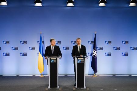BRUSSELS, BELGIUM - Dec 13, 2018: Ukrainian President Petro Poroshenko and NATO Secretary General Jens Stoltenberg during a joint press conference at NATO Headquarters in Brussels Редакционное