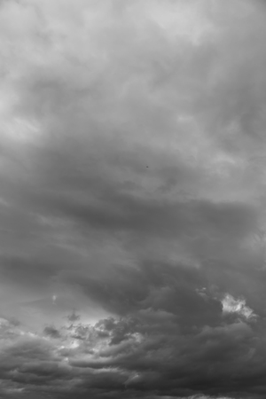 Blurred abstract natural background with clouds in black and white tonality. Abstract nature image for background use.