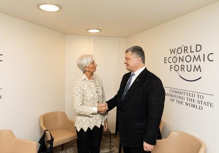 DAVOS, SWITZERLAND - Jan 23, 2019: President of Ukraine Petro Poroshenko and the director of the International Monetary Fund Christine Lagarde during a meeting, in Davos, Switzerland