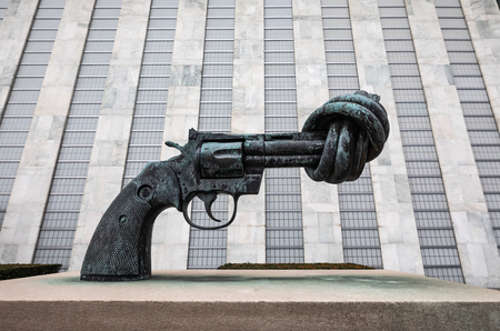 NEW YORK, USA - Feb 20, 2019: Non-Violence is a bronze sculpture by Swedish artist Carl Reutersward of an oversized Colt Python .357 Magnum revolver with a knotted barrel and muzzle pointing upwards