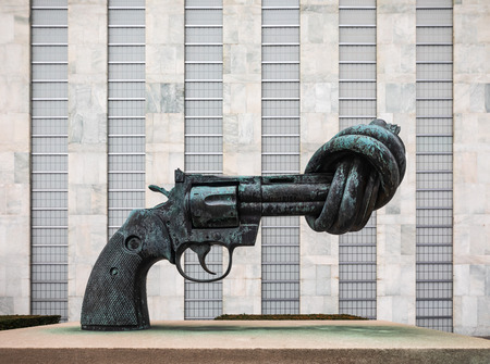NEW YORK, USA - Feb 20, 2019: Non-Violence is a bronze sculpture by Swedish artist Carl Reutersward of an oversized Colt Python .357 Magnum revolver with a knotted barrel and muzzle pointing upwards Sajtókép