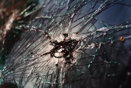 Abstract image of broken glass texture. Close-up broken car windshield. Broken and damaged car