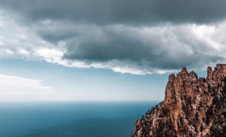 High rocks Ai-Petri of Crimean mountains. Black sea coast and blue sky with clouds Фото со стока