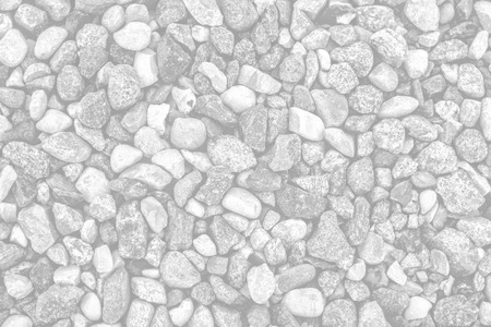Rocks and pebbles on a beach. Image in light gray tonality