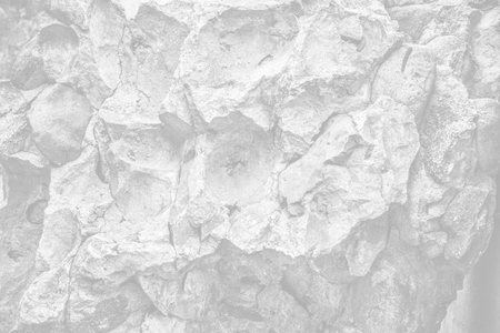 Concrete texture. Weathered stone and concrete wall background. Image in light gray tonality