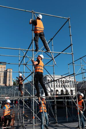 KYIV, UKRAINE - May 03, 2017: Worker prepares billboard to installing new advertisement on the Independence Square in Kyiv Editorial