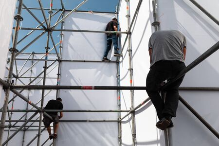 KYIV, UKRAINE - May 05, 2017: Worker prepares billboard to installing new advertisement on the Independence Square in Kyiv.