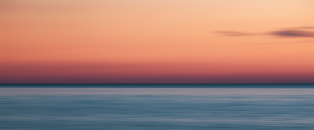 Abstract blurred sea landscape and cloudy sky background