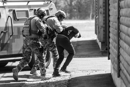 CHERKASY Reg, UKRAINE - May 03, 2019: Demonstrative performances by border guards on the territory of the Main Personnel Training Center of the State Border Service of Ukraine. Detention of a criminal Redakční