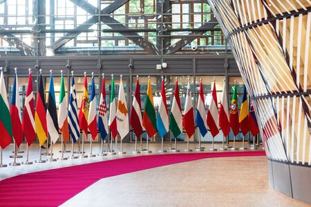 BRUSSELS, BELGIUM - May 13, 2019: Flags on the meeting of EU leaders at the EU headquarters. High Level Conference for Eastern Community Leaders in Brussels