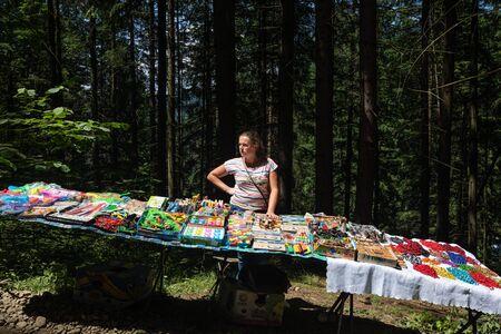 IVANO-FRANKIVSK REG, UKRAINE - Jun. 15, 2019: The seller of children's toys at the festival Polonynsky Summer Standard-Bild - 130700866