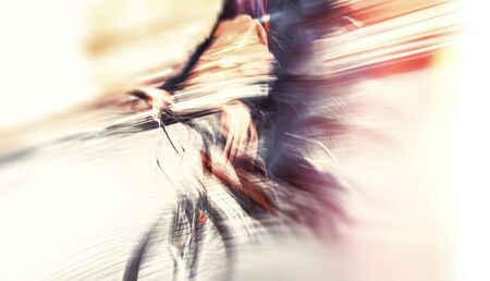 Abstract blurred image of cyclist on the city roadway. Intentional motion blur Stock Photo