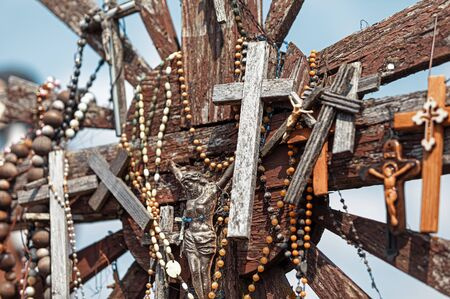 Crucifixion of Christ and a large number of crosses at Hill of Crosses. Hill of Crosses is a unique monument of history and religious folk art in Siauliai, Lithuania.